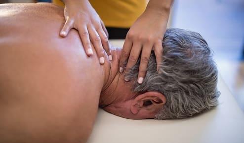 an older man getting a massage.