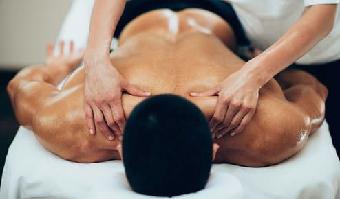 young man getting a trigger point massage.