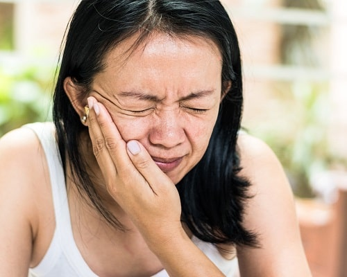 A woman with Ear Pain from TMJ